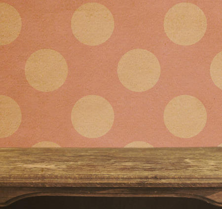 Vintage table on the background of seamless pink polka dots patten  photo