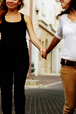two women holding hands photo