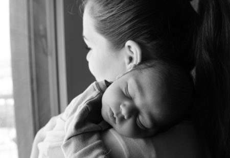 mom holding baby: mother with her newborn baby Stock Photo