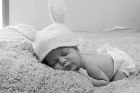 Funny sleeping newborn child photo