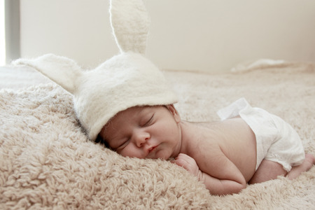 Funny sleeping newborn child photo