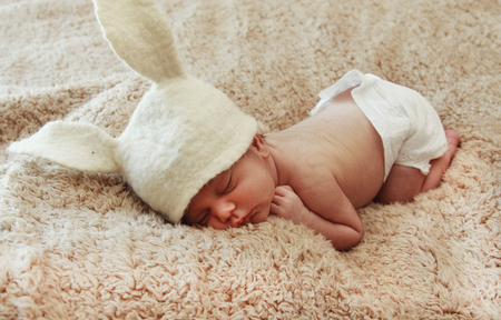 Funny sleeping newborn baby photo