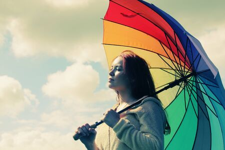 Woman with umbrella. Photo in old color image style. photo