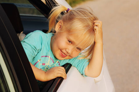 portrait of little girl in the car photo