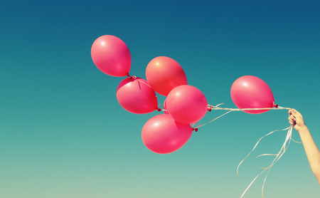 day dream: red balloons on the background of blue sky Stock Photo