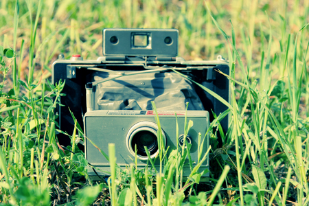 old vintage camera in the field photo