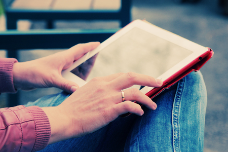 spontaneous: close up womans hands with tablet Stock Photo