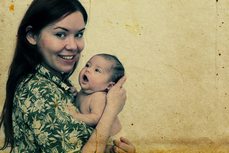 young mother with her baby. Photo in old image style photo