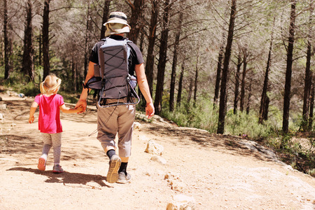 Father hiking with kid photo