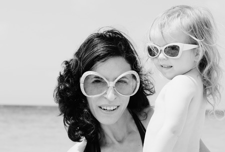 Portrait of mother and her daughter on the beach Stock Photo - 27923165