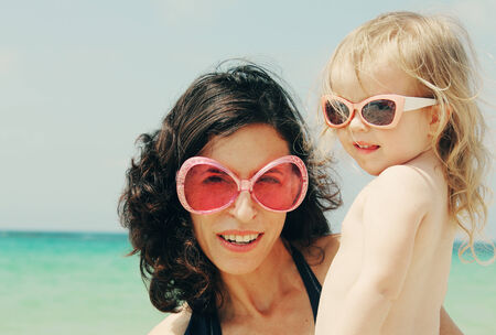 Portrait of mother and her daughter on the beach Stock Photo - 27923166