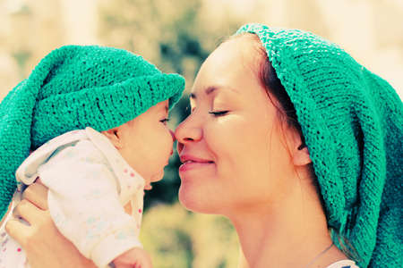 Portrait of happy loving mother and her baby outdoors photo