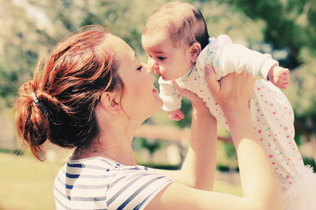 baby love: Portrait of happy loving mother and her baby outdoors