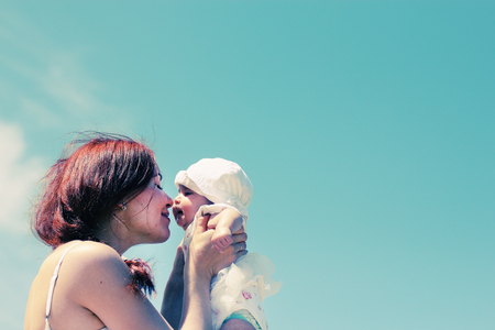 emotional love: Portrait of happy loving mother and her baby at the beach