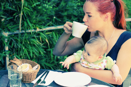 mother and daughter in summer cafe outdoor photo