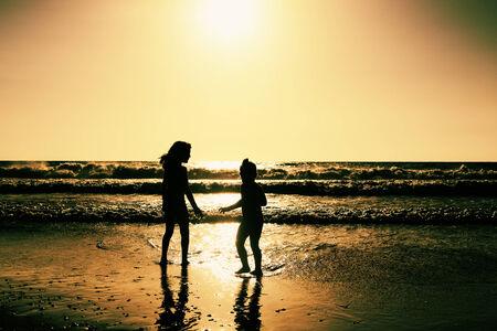 children playing on the beach Stock Photo - 29639873