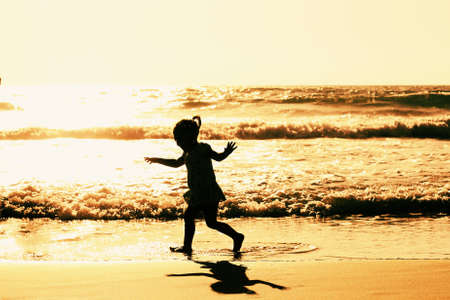 girl playing on the beach photo