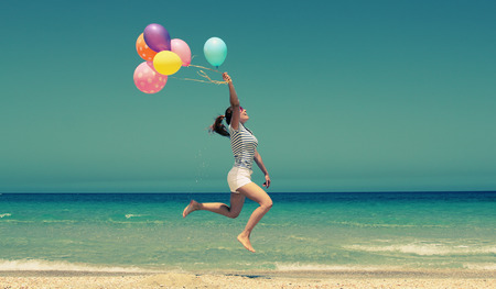 beautiful woman with colorful balloons outside Stock Photo