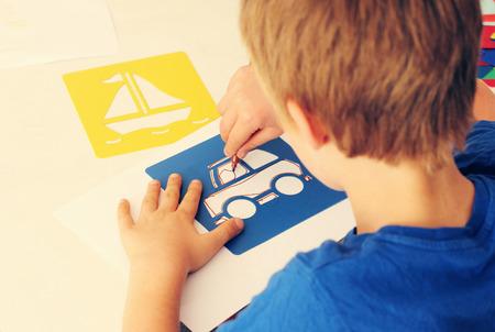 cute 6 years old boy drawing