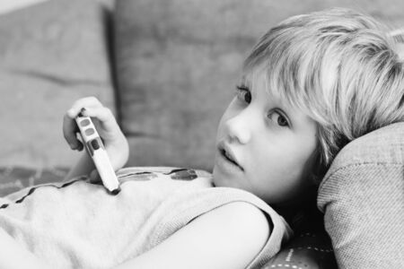 Cute boy with mobile phone photo