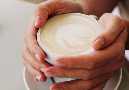 woman hands with cappuccino Standard-Bild