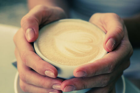 woman hands with cappuccino photo