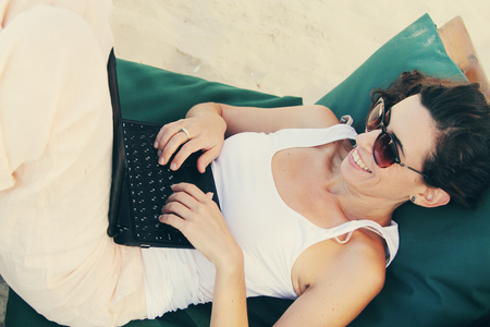 30 years old: woman with laptop Stock Photo