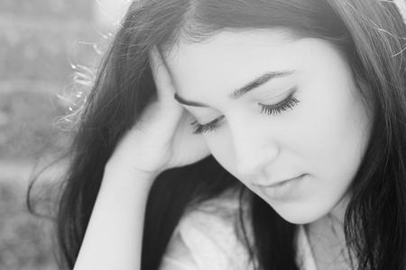 maltreatment: Outdoor portrait of a sad teenage girl