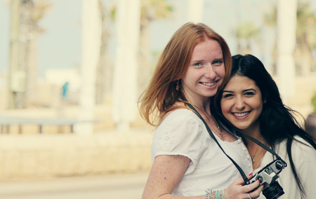 living moment: portrait of two smiling girlfriends Stock Photo