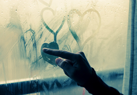 emotional love: beautiful 35 year old woman stands in front of the window