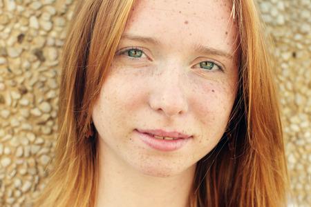Closeup portrait of beautiful young redhead girl Imagens