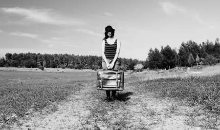 picnicking: Woman standing in the field