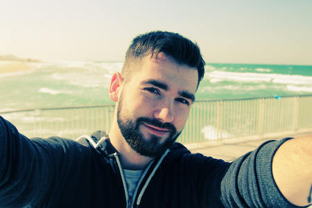 selfie portrait of young man outdoors Banque d'images