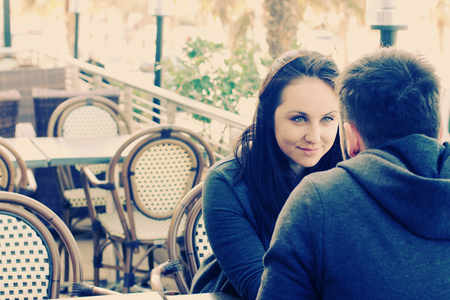 young couple relaxing together in street cafe photo