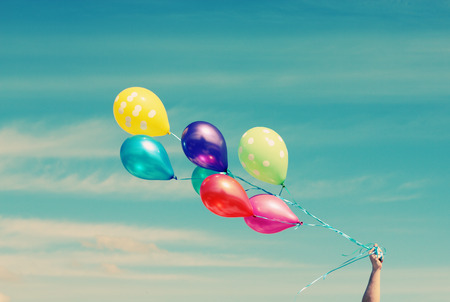 sky idea: colorful balloons on the background of blue sky