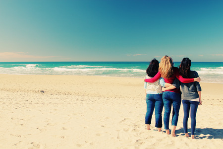 friends hugging: Three best friends walking at seaside