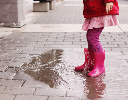 messy kids: Adorable 4 years old girl at rainy day in springtime