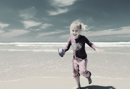 4 years old: 4 years old girl playing on the beach Stock Photo