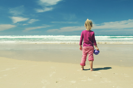 kids playing beach: 4 years old girl playing on the beach Stock Photo