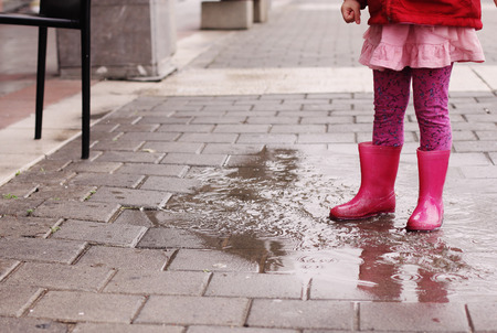 4 years old: Adorable 4 years old girl at rainy day in springtime