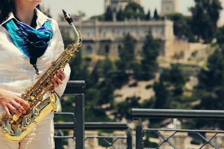 saxophonist: Saxophonist holding saxophone