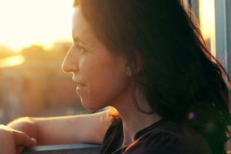 35 years old: Portrait of beautiful 35 years old woman on sunset colors