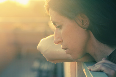 Portrait of beautiful 35 years old woman on sunset colors photo
