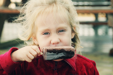 dirty blond: cute 4 years old girl eating ice cream