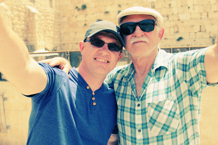 western wall: Selfie portrait of father and adult son near the Western Wall in Jerusalem