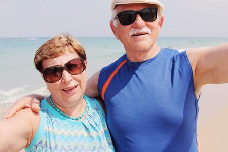 taking a wife: Selfie portrait of senior couple on the beach Stock Photo