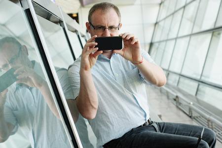 elegant business man: elegant business man with smart phone
