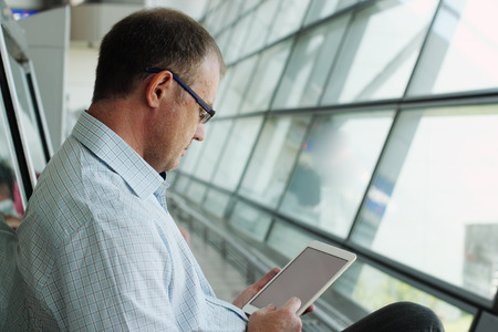 elegant business man: elegant business man with tablet