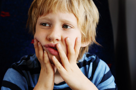 7 years old: Cute 7 years old boy traveling in the train