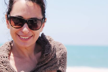 35 years old: Portrait of beautiful 35 years old woman on the beach